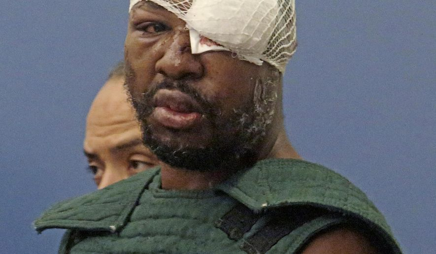 Markeith Loyd, suspected of fatally shooting a Florida police officer, attends his initial court appearance Thursday, Jan. 19, 2017, at the Orange County Jail, in Orlando, Fla. Loyd spoke out of turn and was defiant during the appearance on charges of killing his pregnant ex-girlfriend. He was injured during his arrest Tuesday night following a weeklong manhunt. (Red Huber/Orlando Sentinel via AP, Pool)