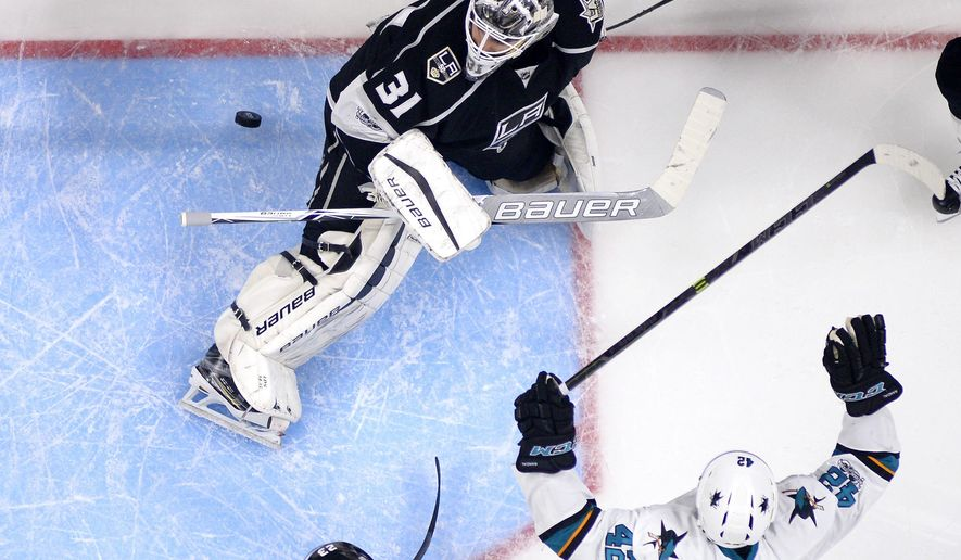 Los Angeles Kings goalie Peter Budaj, left, of Slovakia, gives up a goal to San Jose Sharks center Joe Pavelski, not seen, as right wing Joel Ward, lower right, celebrates during the second period of an NHL hockey game, Wednesday, Jan. 18, 2017, in Los Angeles. (AP Photo/Mark J. Terrill)