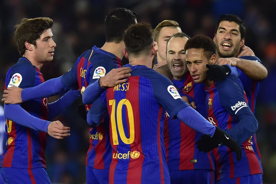 FC Barcelona's Neymar Jr., right, celebrates his goal with Lionel Messi, centre back to camera, after after scoring during the Spanish Copa del Rey, quarter final, first leg soccer match, between FC Barcelona and Real Sociedad, at Anoeta stadium, in San Sebastian, northern Spain, Thursday, Jan.19, 2017. (AP Photo/Alvaro Barrientos)