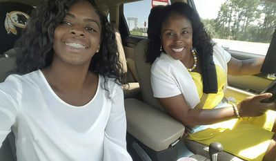 In this undated photo made available by Bamberg Legal, Kaliyah Mobley, left, takes a selfie with Gloria Williams. Court documents show that Mobley was kidnapped from a Florida hospital as an infant and raised by Williams in South Carolina under the name Alexis Manigo. Williams has been charged with abducting Mobley when she was hours old. (Kaliyah Mobley/Bamberg Legal via AP)