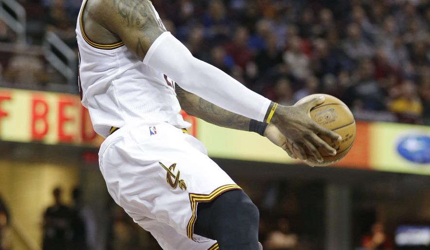 Cleveland Cavaliers' LeBron James (23) looks up to dunk in the second half of an NBA basketball game against the Phoenix Suns, Thursday, Jan. 19, 2017, in Cleveland. The Cavaliers won 118-103.(AP Photo/Tony Dejak)