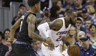 Cleveland Cavaliers' LeBron James (23) drives past Phoenix Suns' Marquese Chriss (0) in the first half of an NBA basketball game, Thursday, Jan. 19, 2017, in Cleveland. (AP Photo/Tony Dejak)