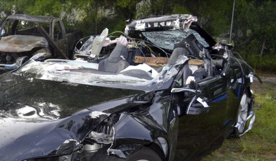 In this photo provided by the National Transportation Safety Board via the Florida Highway Patrol shows a Tesla Model S that was being driven by Joshua Brown, who was killed when the Tesla sedan crashed while in self-driving mode on May 7, 2016. A source tells The Associated Press that U.S. safety regulators are ending an investigation into a fatal crash involving electric car maker Tesla Motors' Autopilot system without a recall. (NTSB via Florida Highway Patrol via AP, File)