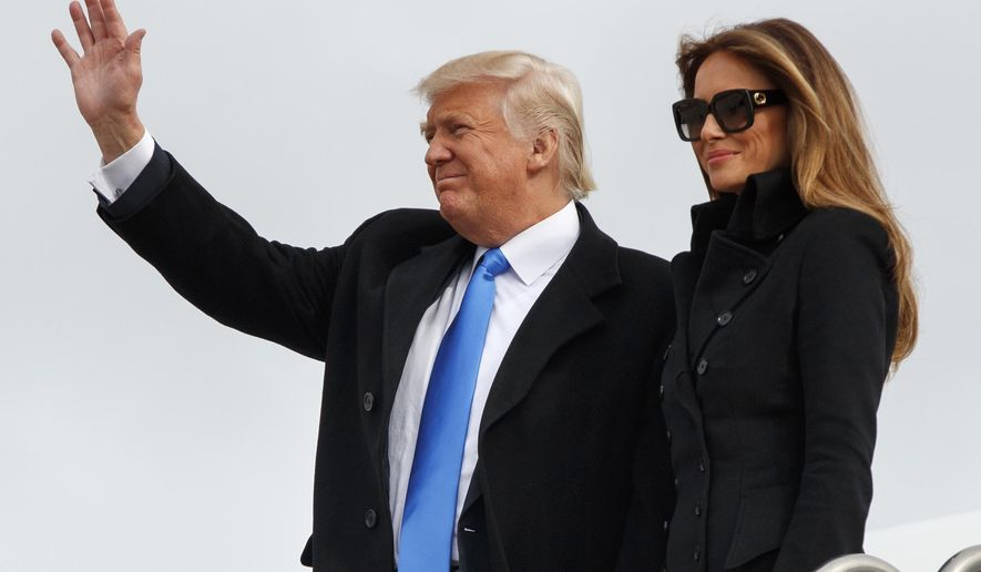 President-elect Donald Trump, accompanied by his wife Melania Trump, waves as they arrive at Andrews Air Force Base, Md., Thursday, Jan. 19, 2017, ahead of Friday's inauguration. (AP Photo/Evan Vucci)