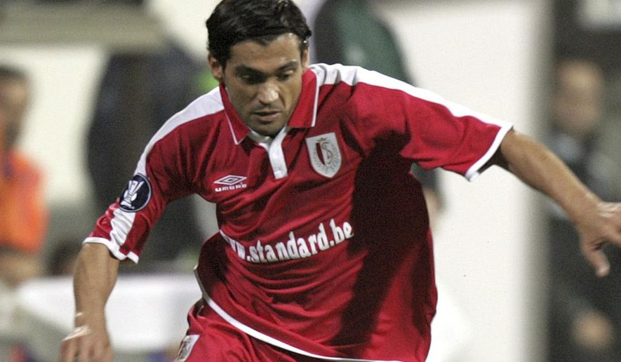FILE - This is a Wednesday, Dec. 1, 2004, file photo of Sergio Conceicao of Standart Liege, playing against Besiktas at Inonu Stadium in Istanbul, Turkey, during their UEFA Cup soccer match.  Conceicao now manages the French team Nantes and the 1-0 home win against Caen on Wednesday Jan. 18, 2017, was the sixth win in seven games since the former Portugal winger took charge.(AP Photo/Murad Sezer, File)