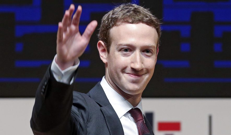 FILE - In this Nov. 19, 2016 file photo, Mark Zuckerberg, chairman and CEO of Facebook, waves at the CEO summit during the annual Asia Pacific Economic Cooperation (APEC) forum in Lima, Peru. Zuckerberg is going to court to gain ownership of isolated pockets of land tucked away within his sprawling estate in Hawaii. Court documents filed by Zuckerberg's attorneys last month say many of the original owners died without a will and courts never established who inherited the land. (AP Photo/Esteban Felix, File)