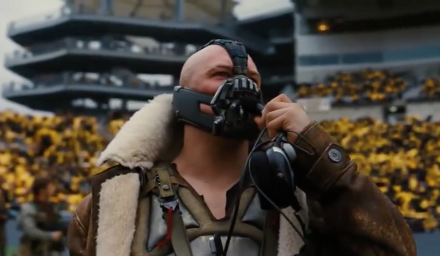 """Actor Tom Hardy is shown here as Bane, the archvillain in the 2012 Batman movie """"The Dark Knight Rises."""" Keen observers on Twitter on Jan. 20, 2017 noticed that a line from President Donald Trump's inaugural address echoed one from Bane in """"Dark Knight."""" (Screen capture from YouTube)"""