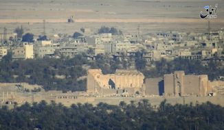 This Dec. 11, 2016, file image made from militant video posted online by the Aamaq News Agency, a media arm of the Islamic State group, purports to show a general view of the ancient ruins of the city of Palmyra, in Homs province, Syria. Islamic State group militant destroyed a landmark ancient Roman monument and parts of the amphitheater in Syria's historic town of Palmyra, the Syrian government and opposition monitoring groups said Friday, Jan. 20, 2017. (Militant Video via AP, File)
