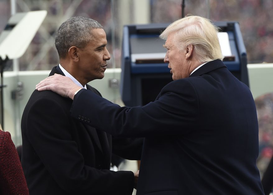 President Barack Obama shake hands with President-elect Donald Trump during the Presidential Inauguration at the US Capitol in Washington, DC, on January 20, 2017. / AFP PHOTO / POOL / SAUL LOEB