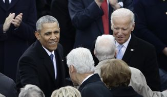 President Barack Obama greets Former President Bill Clinton before the 58th Presidential Inauguration at the U.S. Capitol in Washington, Friday, Jan. 20, 2017. Right is Vice President Joe Biden. (AP Photo/Matt Rourke)
