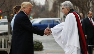 Rev Luis Leon greets President-elect Donald Trump and his wife Melania as they arrive for a church service at St. Johns Episcopal Church across from the White House in Washington, Friday, Jan. 20, 2017, on Donald Trump's inauguration day. (AP Photo/Alex Brandon)