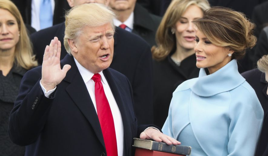Donald Trump is sworn in as the 45th president of the United States as Melania Trump looks on during the 58th Presidential Inauguration at the U.S. Capitol in Washington, Friday, Jan. 20, 2017. (AP Photo/Andrew Harnik) ** FILE **