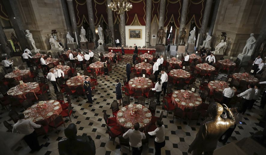 Statuary Hall in the Capitol is set for a luncheon with the newly sworn in president and vice president, Friday, Jan. 20, 2017 in Washington. President-elect Donald Trump will become the 45th United States president when he's sworn in today. (AP Photo/Manuel Balce Ceneta)