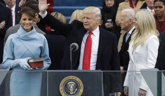 President Donald Trump waves after being sworn in as the 45th president of the United States by Chief Justice John Roberts as Melania Trump looks on during the 58th Presidential Inauguration at the U.S. Capitol in Washington, Friday, Jan. 20, 2017. (AP Photo/Patrick Semansky)