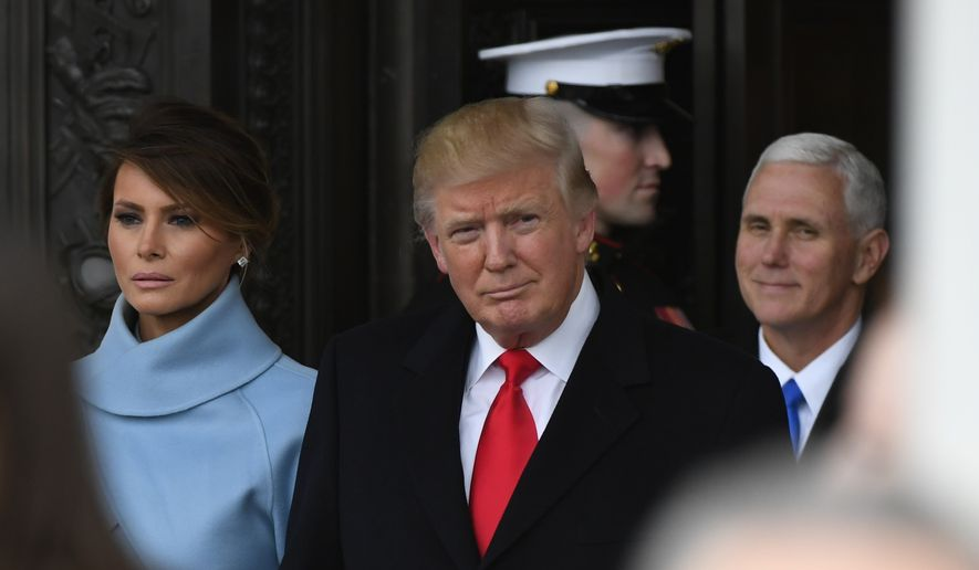 President Donald Trump and first lady Melania Trump depart the Capitol during the 2017 presidential inauguration at the U.S. Capitol Friday, Jan. 20, 2017, in Washington. (Jack Gruber/Pool Photo via AP)