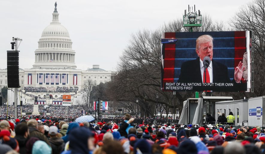 President Donald Trump is seen speaking on video monitor on the National Mall during his inauguration, Friday, Jan. 20, 2017, in Washington. (AP Photo/John Minchillo)