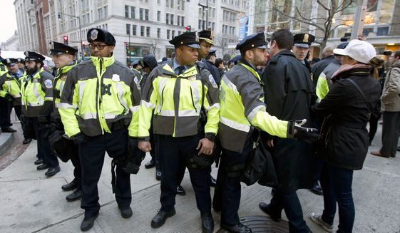 Police officers are shown near a inaugural security checkpoint entrance, Friday, Jan. 20, 2017, ahead of  President-elect Donald Trump's inauguration. ( AP Photo/Jose Luis Magana)