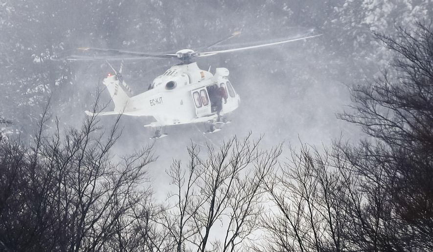 A rescue helicopter approaches the area in Rigopiano, central Italy, where a hotel has been buried under an avalanche on Wednesday, to recover some people who have been reportedly extracted alive from the debris, Friday, Jan. 20, 2017. (AP Photo Gregorio Borgia)