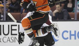Anaheim Ducks' Cam Fowler, top, jumps to avoid a collision with Colorado Avalanche's Gabriel Landeskog, of Sweden, during the first period of an NHL hockey game Thursday, Jan. 19, 2017, in Anaheim, Calif. (AP Photo/Jae C. Hong)
