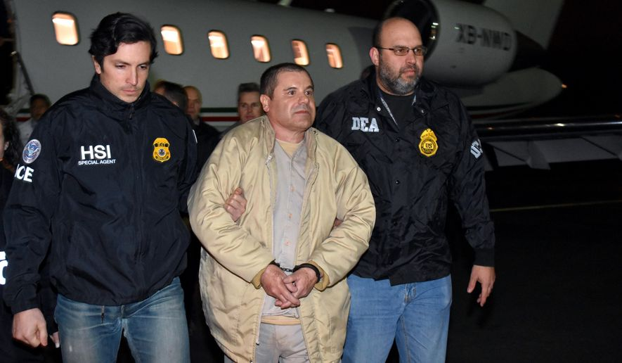 "In this photo provided U.S. law enforcement, authorities escort Joaquin ""El Chapo"" Guzman, center, from a plane to a waiting caravan of SUVs at Long Island MacArthur Airport on Thursday, Jan. 19, 2017, in Ronkonkoma, N.Y. The infamous drug kingpin who twice escaped from maximum-security prisons in Mexico was extradited at the request of the U.S. to face drug trafficking and other charges, and landed in New York late Thursday, a federal law enforcement official said. (U.S. law enforcement via AP)"