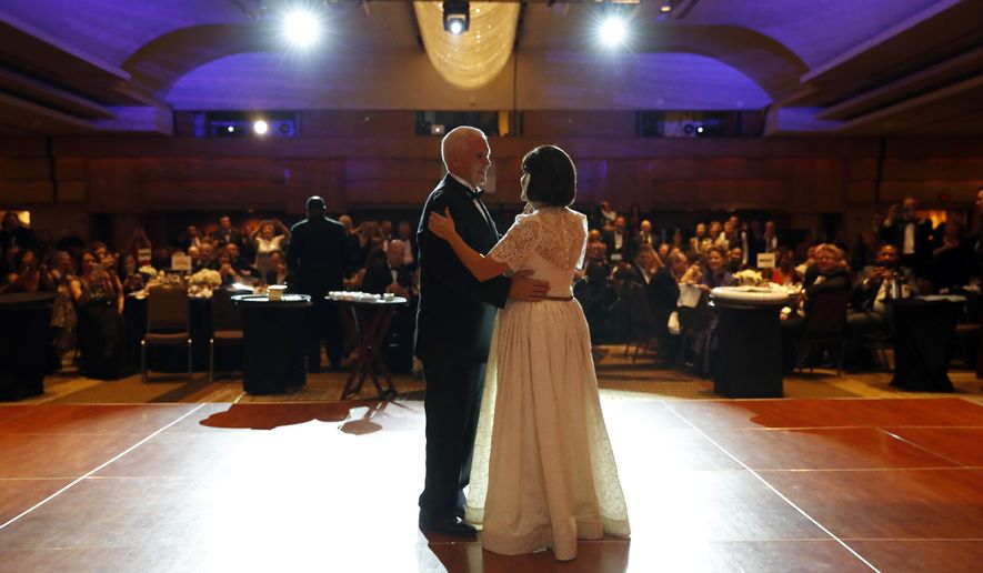 Vice president-elect Mike Pence and his wife Karen Pence dance at the Indiana Inaugural Ball, Thursday, Jan. 19, 2017 in Washington. (AP Photo/Alex Brandon)