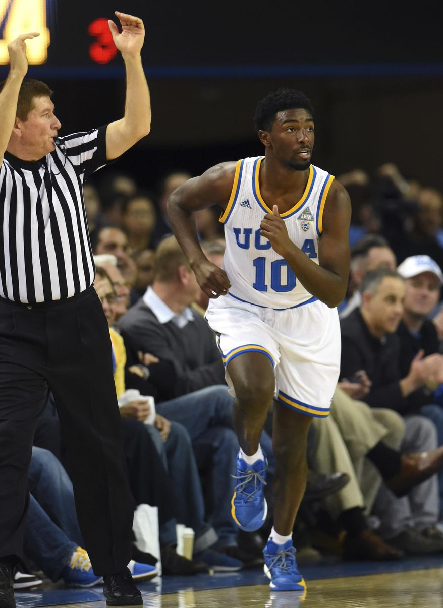 UCLA guard Isaac Hamilton runs downcourt after making a three-point shot during the first half of an NCAA college basketball game against Arizona State in Los Angeles, Thursday, Jan. 19, 2017. (AP Photo/Michael Owen Baker)