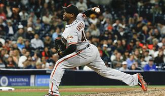 FILE - In this May 19, 2016, file photo, San Francisco Giants closer Santiago Casilla pitches against the San Diego Padres in the ninth inning of the Giants' 3-1 victory in a baseball game in San Diego. Relief pitcher Santiago Casilla is crossing the bay again, re-joining the Oakland Athletics with a two-year contract Friday, Jan. 20, 2017,  after seven seasons with San Francisco. Casilla has spent his entire big league career between the two Bay Area teams; his initial six seasons were with Oakland. (AP Photo/Lenny Ignelzi, File)