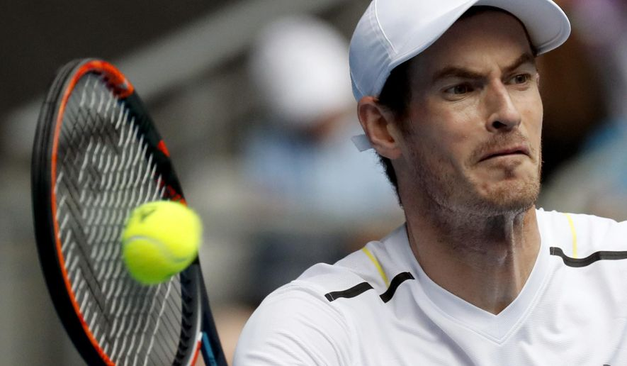Britain's Andy Murray makes a forehand return to United States' Sam Querrey during their third round match at the Australian Open tennis championships in Melbourne, Australia, Friday, Jan. 20, 2017. (AP Photo/Kin Cheung)