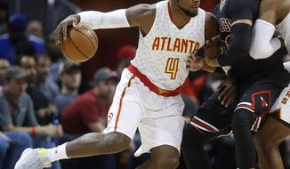 Atlanta Hawks forward Paul Millsap (4) drives against Chicago Bulls forward Taj Gibson (22) in the first half of an NBA basketball game Friday, Jan. 20, 2017, in Atlanta. (AP Photo/John Bazemore)