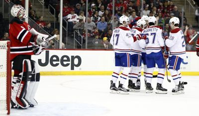 The Montreal Canadiens celebrate a goal by Alex Galchenyuk (27) as New Jersey Devils goalie Keith Kinkaid, left, waits during the first period of an NHL hockey game, Friday, Jan. 20, 2017, in Newark, N.J. (AP Photo/Julio Cortez)