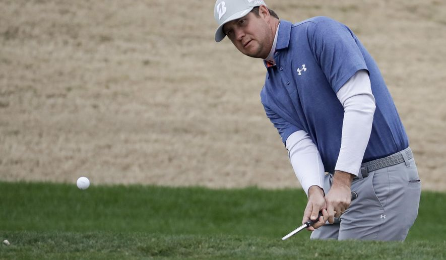 Hudson Swafford chips to the 11th hole during the second round of the CareerBuilder Challenge golf tournament on the Jack Nicklaus Tournament Course at PGA West Friday, Jan. 20, 2017, in La Quinta, Calif. (AP Photo/Chris Carlson)