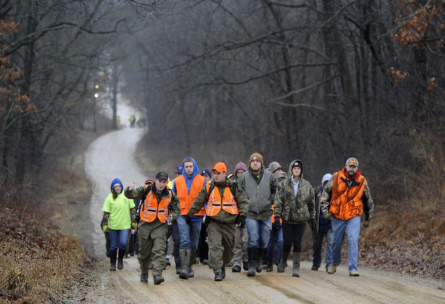 CORRECTS SPELLING OF LAST NAME TO LYON, NOT LYONS - Volunteers gather to search for Jace Lyon, 9, in a rural area just north of Hillsdale, Mich.,  Friday, Jan. 20, 2017. Lyon has been missing since Wednesday evening, Jan. 18. (J. Scott Park/Jackson Citizen Patriot via AP)