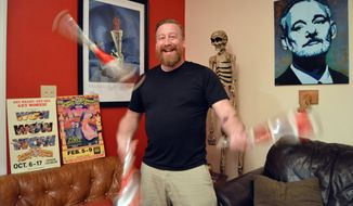 FOR RELEASE SUNDAY, JANUARY 22, 2017, AT 12:01 A.M. EST. Bryan Fulton, 38, tosses juggling pins in his living room in Conway, S. C., on Monday, Jan. 16, 2017. Fulton spent six years as a clown touring with the Ringling Bros. and Barnum and Bailey circus. The company announced it would shut down in May after 146 year run, citing higher operating costs, lower attendance and shifting public opinion regarding the treatment of animals. (Josh Bell/The Sun News via AP)