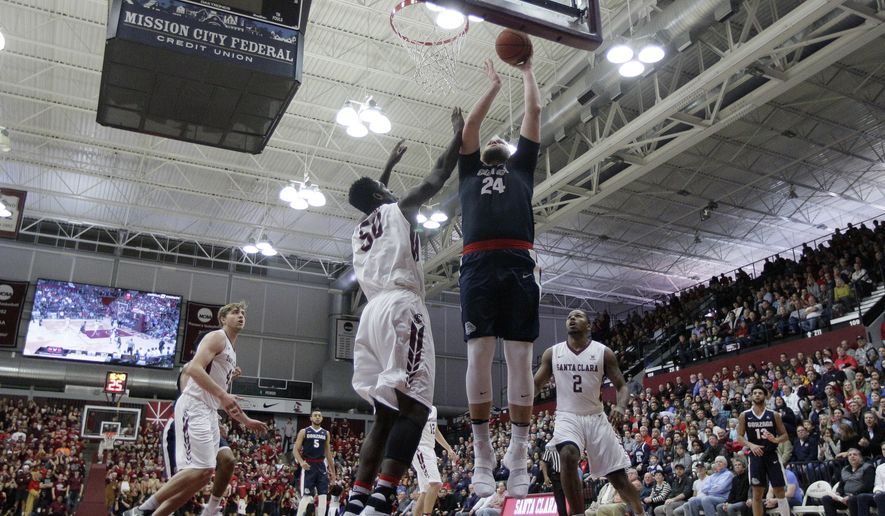 Gonzaga center Przemek Karnowski (24) shoots over Santa Clara center Emmanuel Ndumanya (50) during the first half of an NCAA college basketball game Thursday, Jan. 19, 2017, in Santa Clara, Calif. (AP Photo/Marcio Jose Sanchez)