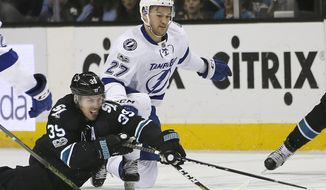 San Jose Sharks center Logan Couture (39) battles for the puck against Tampa Bay Lightning left wing Jonathan Drouin (27) during the first period of an NHL hockey game, Thursday, Jan. 19, 2017, in San Jose, Calif. (AP Photo/Tony Avelar)
