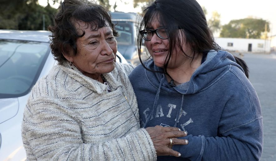ADVANCE FOR TUESDAY, JAN. 24, 2017 - This Dec. 23, 2016 photo shows Tamara Alcala Dominguez reuniting with her grandmother Petra Bello Suarez in their home town of Molcaxac, Puebla state, Mexico, during Alcala's first return home since she left Mexico for the U.S. as a toddler. Alcala's mother left her with her grandmother at age 2 when she went to seek a better life in the U.S. A year later, the little girl joined her mother in the U.S., and for two decades Alcala's undocumented status prevented her from returning to Mexico to see her grandmother and other relatives. A special program allowed her to make her first journey back to Mexico, and return safely. (AP Photo/Pablo Spencer)