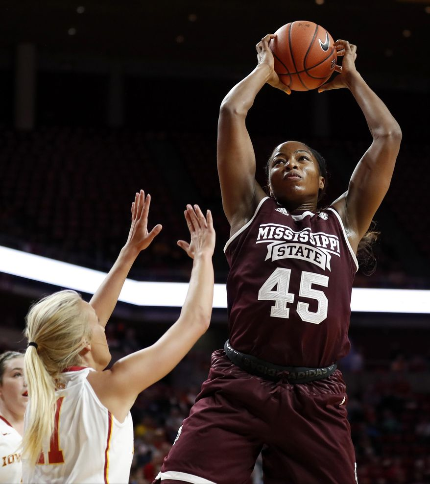 FILE - In this Dec. 3, 2016, file photo, Mississippi State center Chinwe Okorie (45) grabs a rebound over Iowa State guard Jadda Buckley (11) during the first half of an NCAA college basketball game, in Ames, Iowa. Mississippi State's roster hasn't changed much since last season, when the program won 28 games and made the NCAA Tournament's Sweet 16. But the Bulldogs have hit a new level so far this season. (AP Photo/Charlie Neibergall, File)