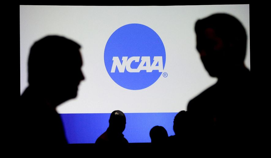 People talk after a panel discussion at the NCAA Convention Thursday, Jan. 19, 2017, in Nashville, Tenn. (AP Photo/Mark Humphrey)