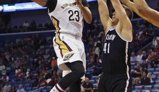 New Orleans Pelicans forward Anthony Davis (23) makes a pass after being blocked near the basket by Brooklyn Nets center Justin Hamilton (41) during the first half of an NBA basketball game in New Orleans, Friday, Jan. 20, 2017. (AP Photo/Max Becherer)