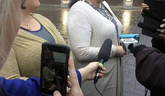 Eve Shanklin, 42, of Bellevue, Neb., sister of homicide victim Seth Hansen, talks to reporters Friday, Jan. 20, 2017, outside the Douglas County Correctional Center in Omaha, Neb. Shanklin told reporters that she's pleased that bond was denied for 45-year-old Dirk Blume, accused of running down and killing her brother, Seth Hansen, on Jan. 7 outside an Omaha convenience store. (AP Photo/Margery Beck)