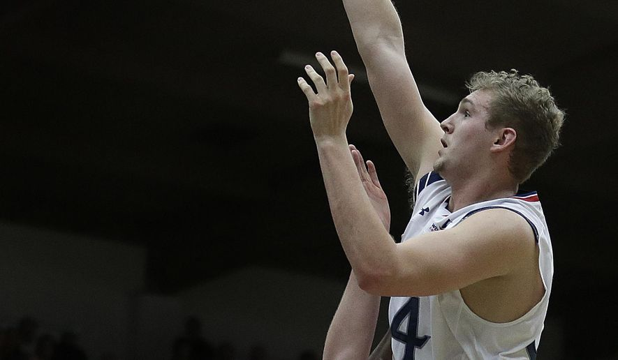 Saint Mary's Jock Landale, right, shoots over Pacific's Jacob Lampkin during the second half of an NCAA college basketball game Thursday, Jan. 19, 2017, in Moraga, Calif. (AP Photo/Ben Margot)