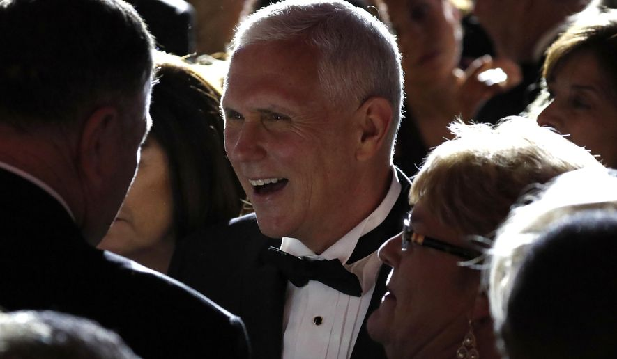 Vice president-elect Mike Pence, center, greets supporters at the Indiana Inaugural Ball, Thursday, Jan. 19, 2017 in Washington. (AP Photo/Alex Brandon)