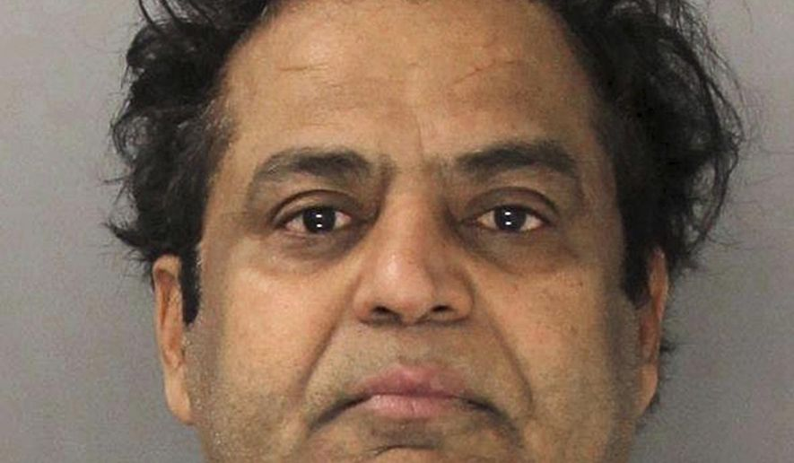 This Friday, Jan. 20, 2017, photo provided by the Montgomery County District Attorney's Office in Norristown, Pa., shows jewelry business owner Wasim Shazad of East Norriton Township, Pa. Prosecutors say Shazad sells jewelry out of three storefronts on Philadelphia's Jewelers Row, and he was arrested Friday, Jan. 20, 2017, on charges he allegedly fenced stolen jewelry from among more than $1.5 million in property burglarized between August 2015 and July 2016 from 15 high-end residences in three southeastern Pennsylvania counties, Chester County, Delaware County and Montgomery County. (Montgomery County District Attorney's Office via AP)