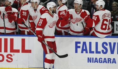 Detroit Red Wings forward Frans Nielsen (51) celebrates his goal during the first period of the team's NHL hockey game against the Buffalo Sabres, Friday, Jan. 20, 2017, in Buffalo, N.Y. (AP Photo/Jeffrey T. Barnes)