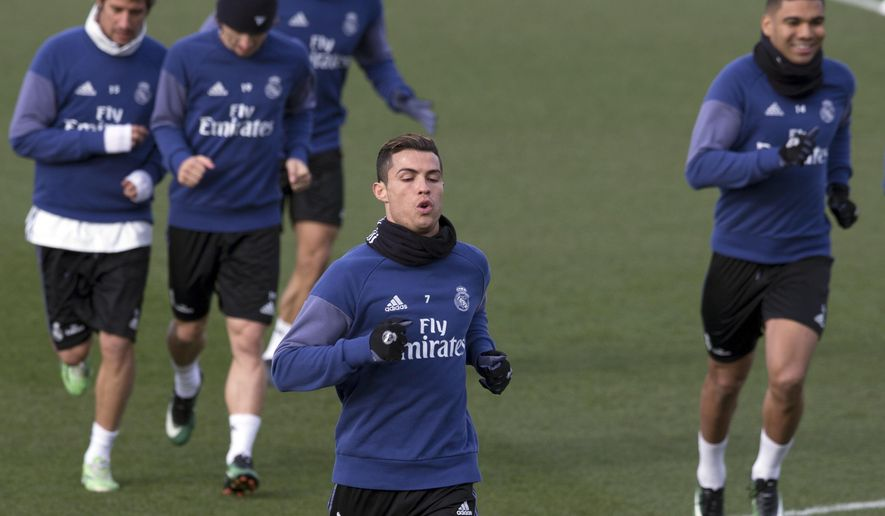 Real Madrid's Cristiano Ronaldo runs with teammates during a training session in Madrid, Spain, Friday Jan. 20, 2017. Real Madrid will play Malaga Saturday in a Spanish La Liga soccer match after having lost their last two games. (AP Photo/Paul White)