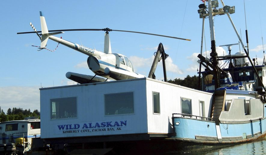 This 2014 photo shows the Wild Alaskan, a converted crabbing boat that had been used as a strip club, moored near downtown Kodiak, Alaska. A sentencing hearing has been rescheduled for Darren Byler, who was found guilty of illegally dumping human waste into a harbor from the boat. Byler had been scheduled for sentencing in Anchorage Thursday, Jan. 19, 2016, but his attorney, John Cashion, said Byler's flight from Kodiak Island was delayed and the sentencing is now set for Friday.  (Kodiak Daily Mirror via AP)