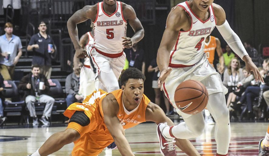 FILE - In this Jan. 17, 2017, file photo, Mississippi guard Breein Tyree (4), right, comes up with the ball in front of Tennessee forward Grant Williams (2) during an NCAA college basketball game in Oxford, Miss. Tennessee doesn't know how its young roster will perform from one game to the next, which has the Volunteerrs at .500 and unable to sustain success. (Bruce Newman/Oxford Eagle via AP, File)
