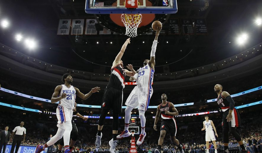 Philadelphia 76ers' Robert Covington (33) goes up for a shot against Portland Trail Blazers' Mason Plumlee (24) during the first half of an NBA basketball game, Friday, Jan. 20, 2017, in Philadelphia. (AP Photo/Matt Slocum)