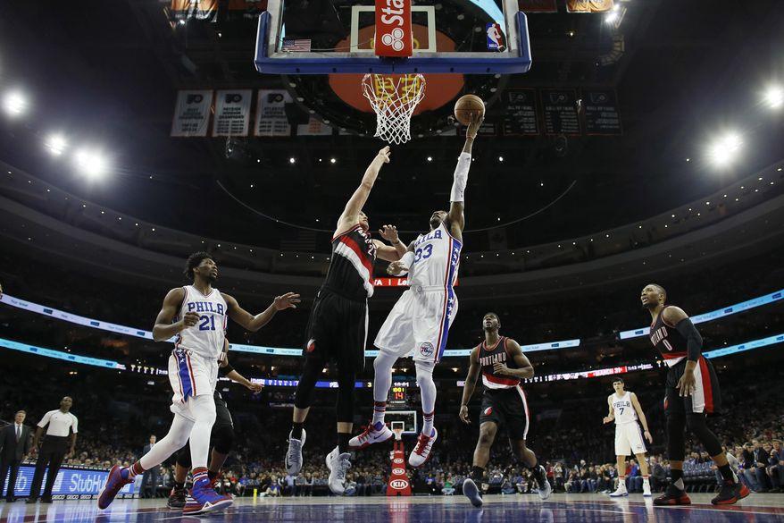 Philadelphia 76ers' Robert Covington (33) goes up for a shot against Portland Trail Blazers' Mason Plumlee (24) during the first half of an NBA basketball game, Friday, Jan. 20, 2017, in Philadelphia. (AP Photo/Matt Slocum)