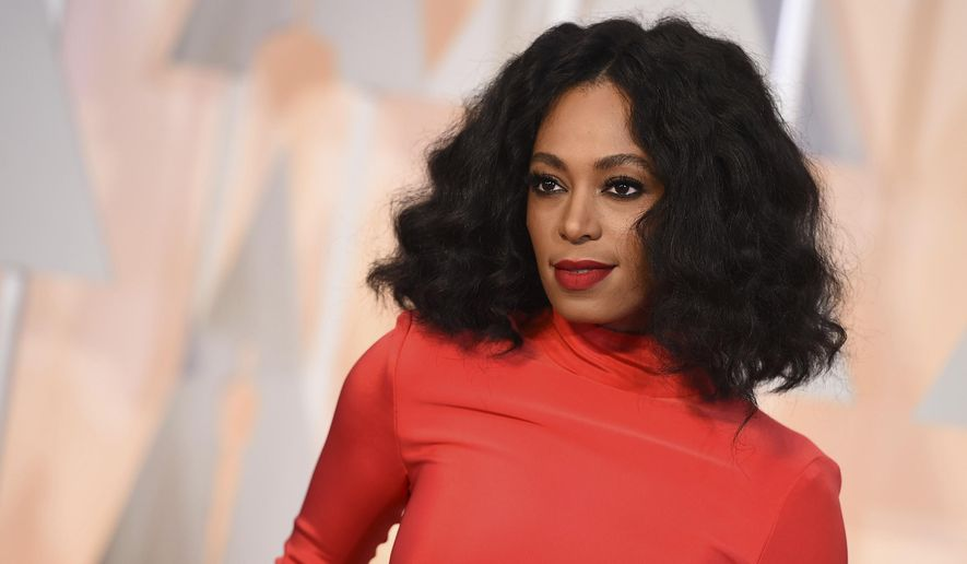 FILE - In this Feb. 22, 2015 file photo, Solange Knowles arrives at the Oscars at the Dolby Theatre in Los Angeles.  While the official pre-inaugural concert attended by Donald Trump was heavy on country music, it was Solange Knowles and Esperanza Spalding that entertained an enthusiastic gathering, Thursday, Jan. 19, 2017,  at the Peace Ball, an alternative inaugural event organized by progressive activists.(Photo by Jordan Strauss/Invision/AP)